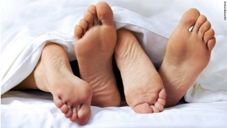 131122232657-sex-couple-feet-bed-story-top